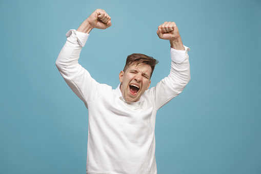 941370476 istock photo Winning success man happy ecstatic celebrating being a winner. Dynamic energetic image of male model 944642746