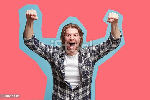 istock Winning success man happy ecstatic celebrating being a winner. Dynamic energetic image of male model 945544512