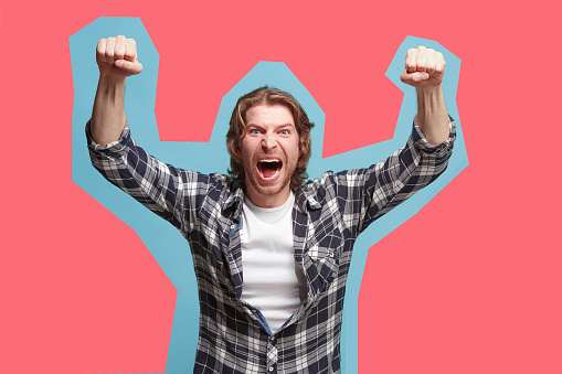 941370476 istock photo Winning success man happy ecstatic celebrating being a winner. Dynamic energetic image of male model 945544512