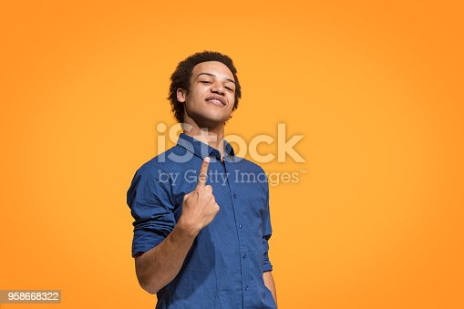 istock Winning success man happy ecstatic celebrating being a winner. Dynamic energetic image of male model 958668322