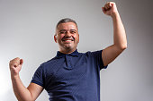 istock Winning success man happy ecstatic celebrating being a winner. 1277382153