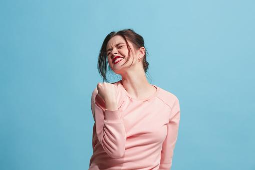 istock Winning success woman happy ecstatic celebrating being a winner. Dynamic energetic image of female model 921730962