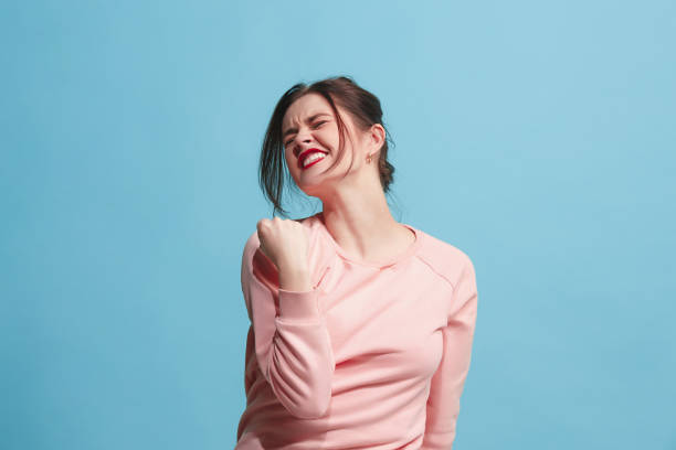 Winning success woman happy ecstatic celebrating being a winner. Dynamic energetic image of female model stock photo