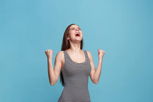 istock Winning success woman happy ecstatic celebrating being a winner. Dynamic energetic image of female model 925640286