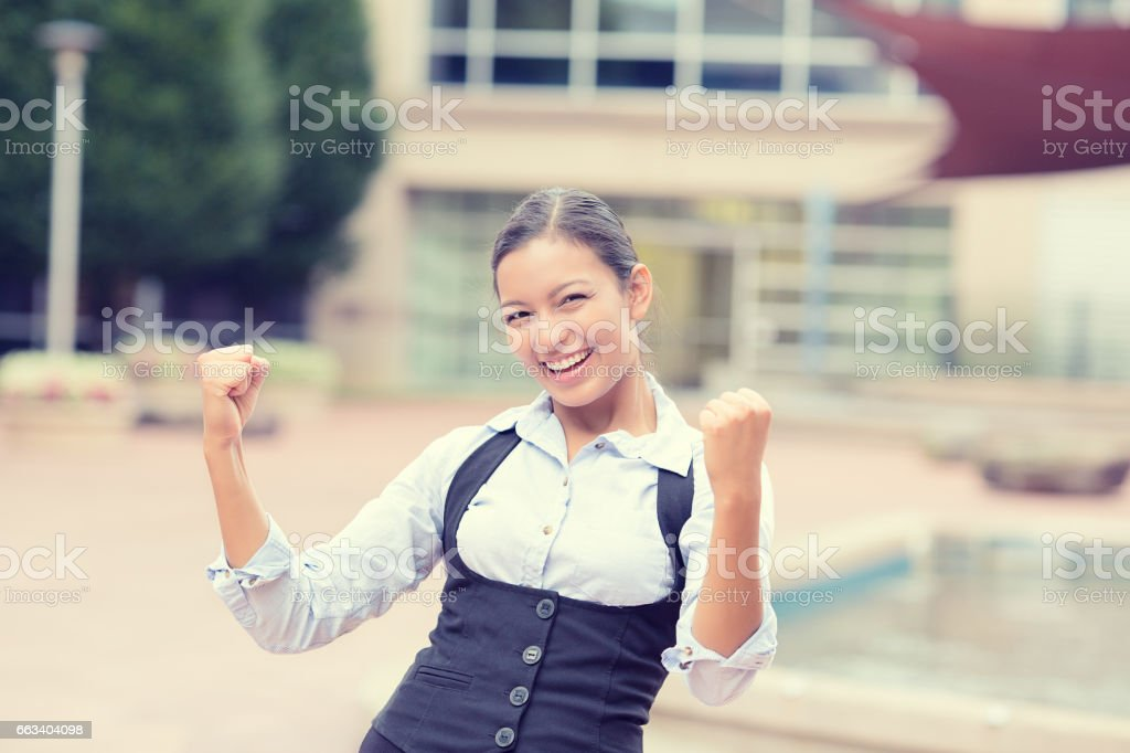winning successful young business woman happy ecstatic celebrating being winner stock photo