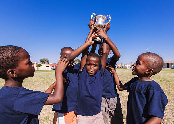 Winning team lifting trophy, Gugulethu, Cape Town, South Africa foto