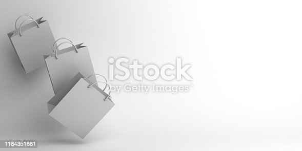 istock Winter abstract design creative concept, flying shopping bag on white background studio lighting, copy space text area. 1184351661