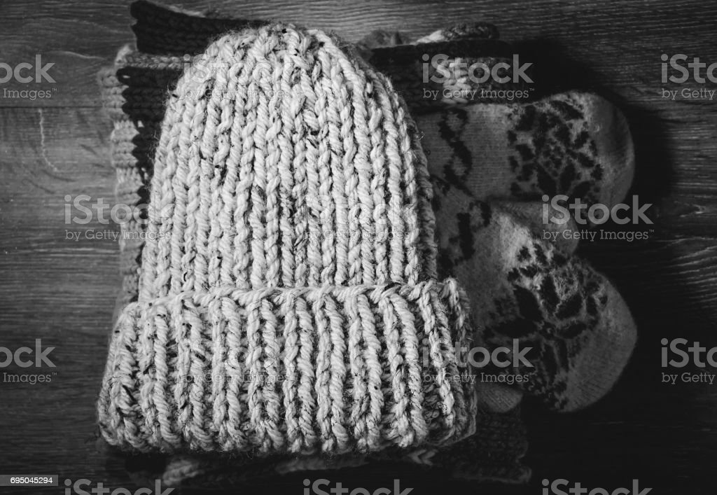 Winter accessories. Knitted hat, gloves and scarf stock photo