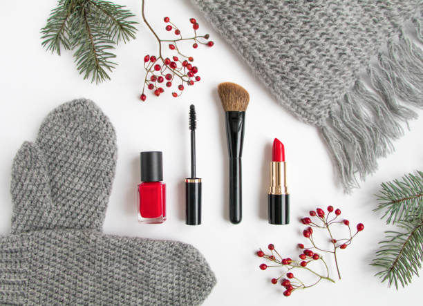 winter accessories with cosmetics and clothes. flat lay, top view - herbst nagellack stock-fotos und bilder