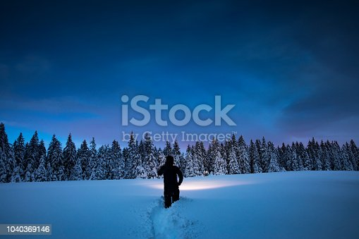 Night hiking in winter conditions.