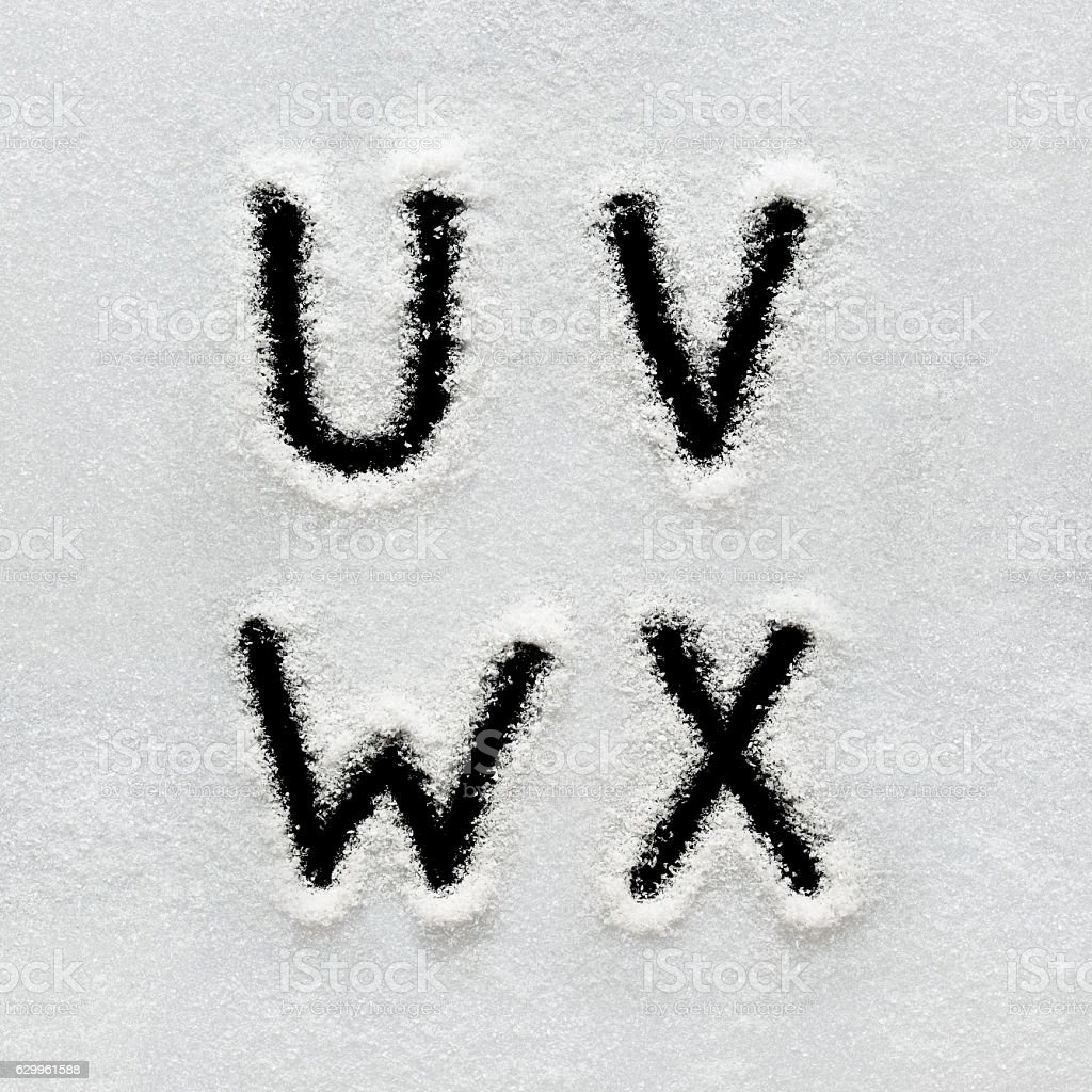 Winter alphabet, symbols and numbers hand written on snow. - foto de stock
