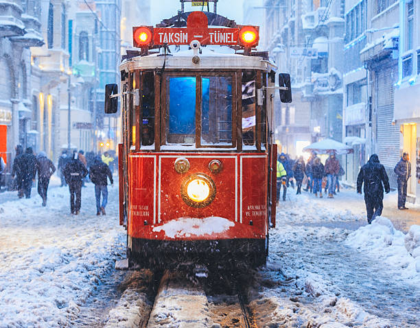 winter and red tram in istiklal street, beyoglu, istanbul. - istiklal avenue bildbanksfoton och bilder