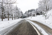 Winter asphalt road covered with snow and advertisement for your text