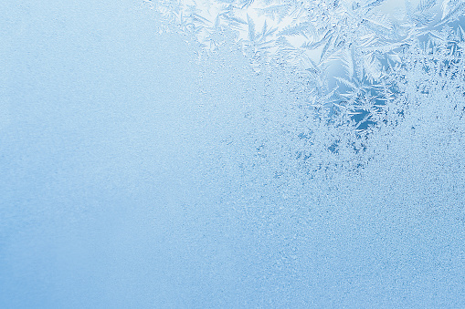 Winter background, frost on window. Frosted glass