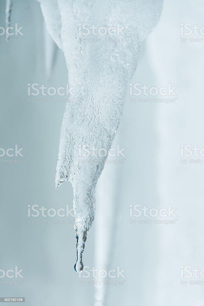 Winter background. Ice stalactites that drips stock photo