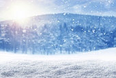 Falling snow over winter landscape with copy space