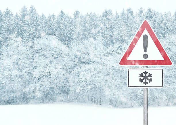Winter Background - Snowy Landscape with Warning Sign stock photo