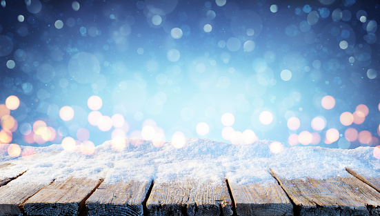 Holiday Background - Wooden Table With Snow And Bokeh In The Night