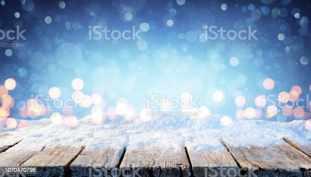 Winter background snowy table with christmas lights in the night picture id1070470798?b=1&k=6&m=1070470798&s=612x612&h=oa3m3txpgfjbbh6g  gpaohnd1vnoiqjft dy67gdnm=