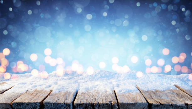 winter background - snowy table with christmas lights in the night - christmas table imagens e fotografias de stock