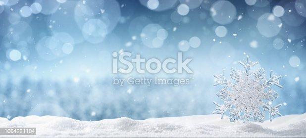 Winter background, ice crystal snowflake in the snow with copy space