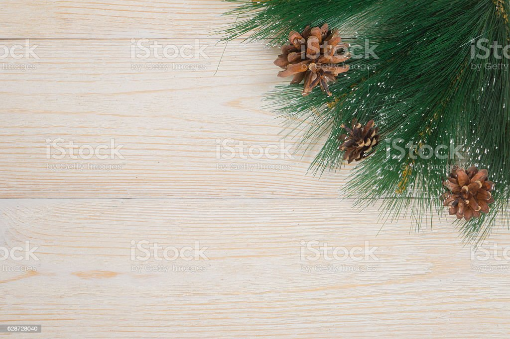 winter background with pine needles and cones on white rustic stock photo
