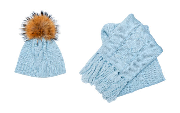Winter beanie and scarf set isolated on white background Winter beanie and scarf set isolated on white background bonnet stock pictures, royalty-free photos & images