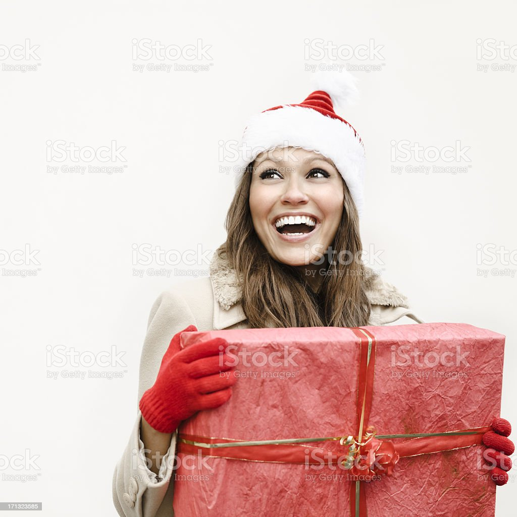 Winter beauty holding a Christmas present royalty-free stock photo
