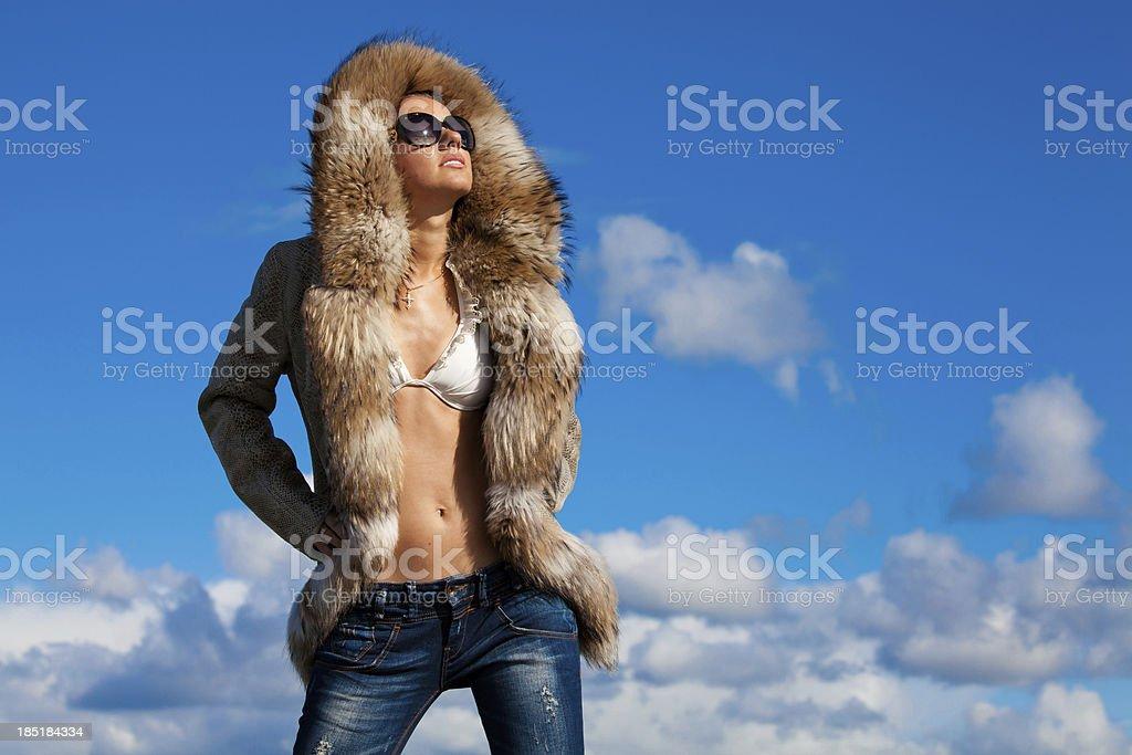 Winter beauty in fur coat stock photo