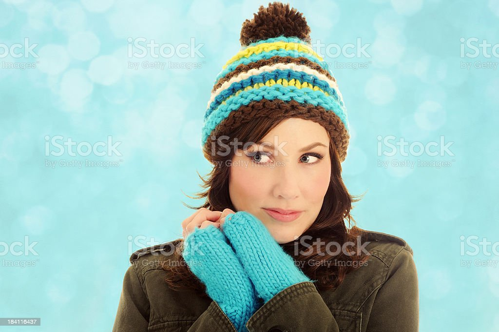 Winter Beauty Snuggled Up In Turquoise Hat and Fingerless Mittens stock photo