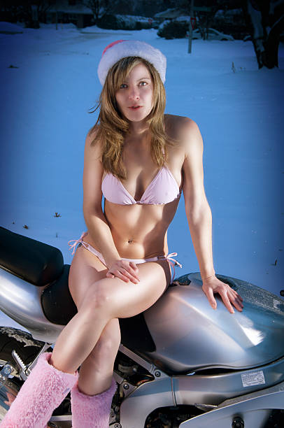 winter biker-bikini - brustpiercing stock-fotos und bilder