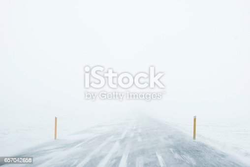 657042754 istock photo Winter Blizzard in the driving road in Iceland 657042658