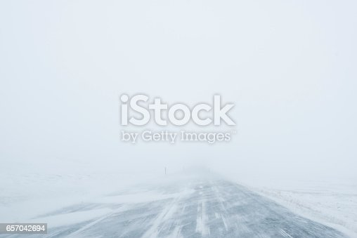 657042754 istock photo Winter Blizzard in the driving road in Iceland 657042694