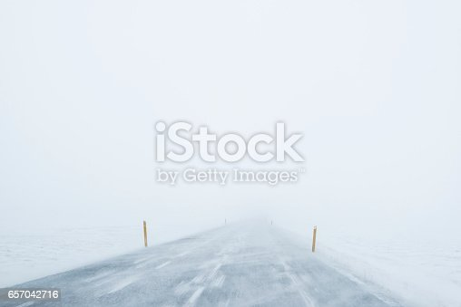 657042754 istock photo Winter Blizzard in the driving road in Iceland 657042716