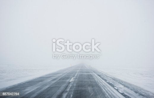 istock Winter Blizzard in the driving road in Iceland 657042754