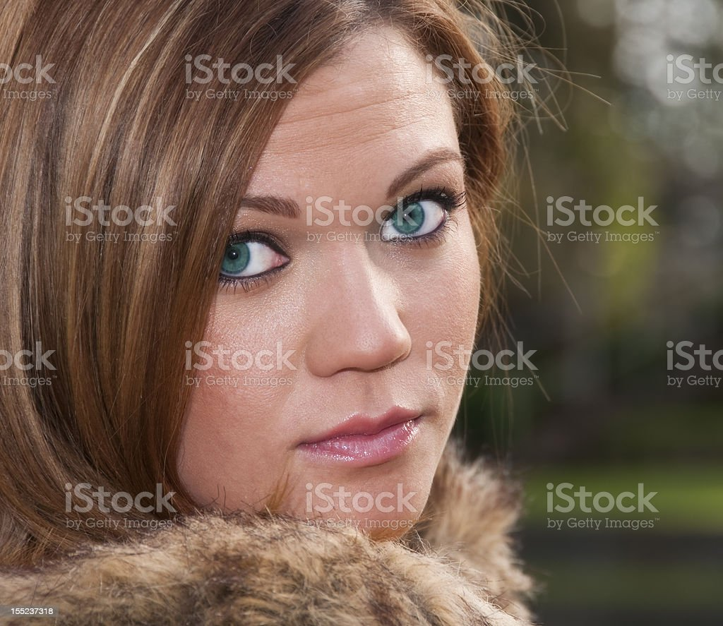 Winter Blue Eyed Young Woman stock photo