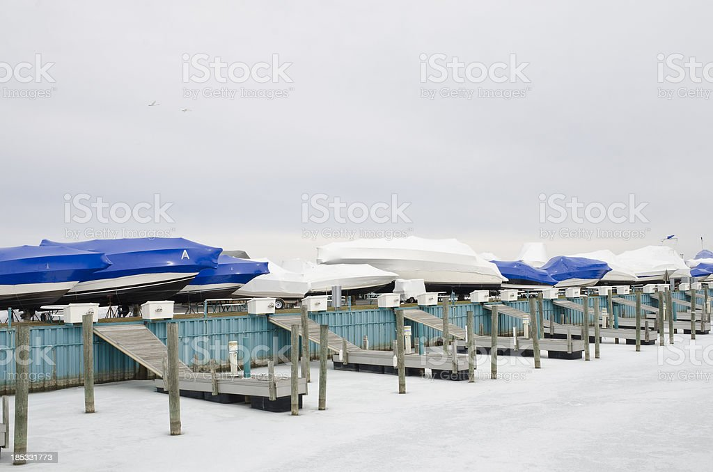 Winter boat storage at dock stock photo