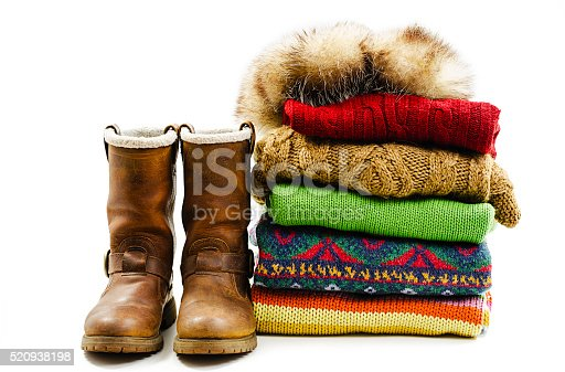 istock Winter boots, cap and stack of various sweaters. Winter style 520938198
