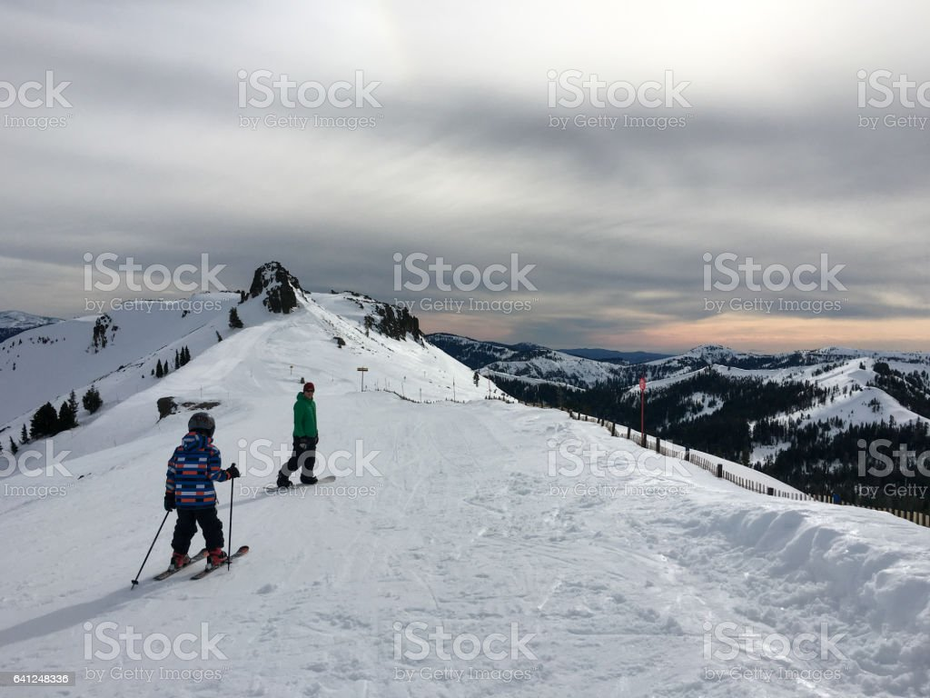 Winter Breaks son and father ski together stock photo