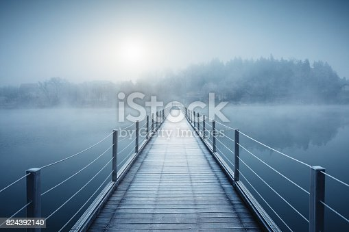 Footbridge over the lake at sunrise (Šmartinsko lake, Celje, Slovenia).
