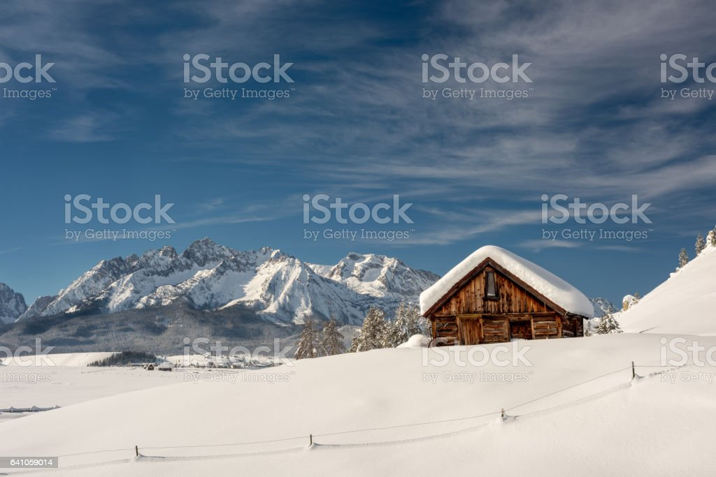 Winter cabin in the Sawtooths of Idaho stock photo