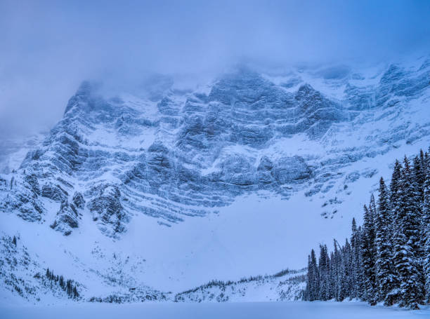 Winter Canadian Rockies, Alberta Canada Surrounding view of mountains from Rawson Lake. kananaskis country stock pictures, royalty-free photos & images