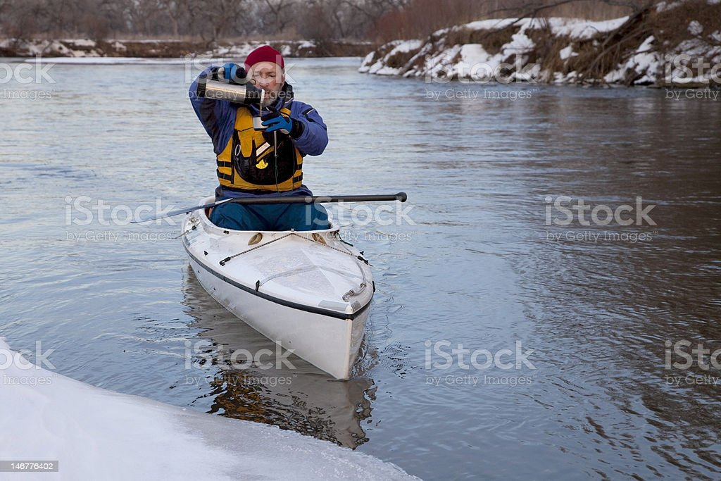 winter canoe - break for hot tea royalty-free stock photo