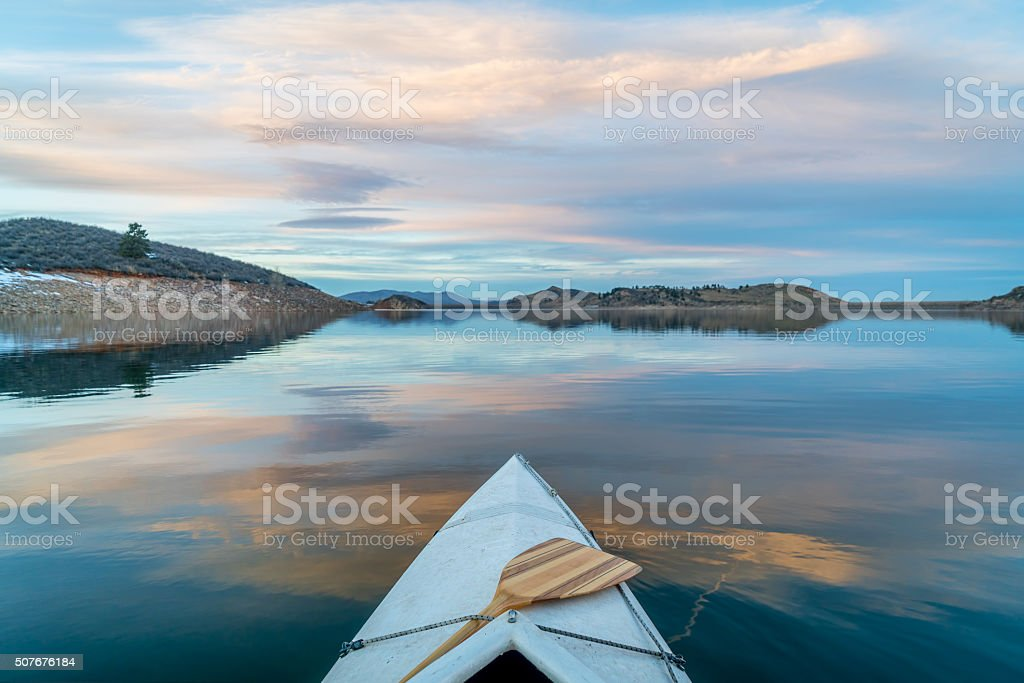 winter canoe paddling in Colorado stock photo