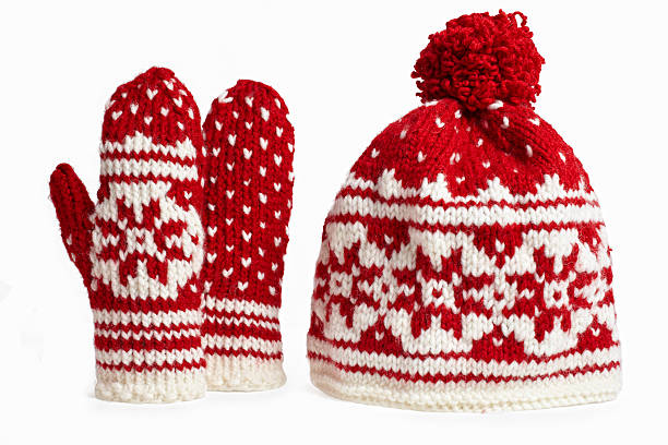 winter cap and mittens knitted with motifs. on white stock photo
