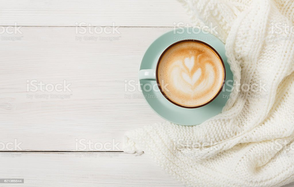 Winter cappuccino coffee cup on white wood background stock photo