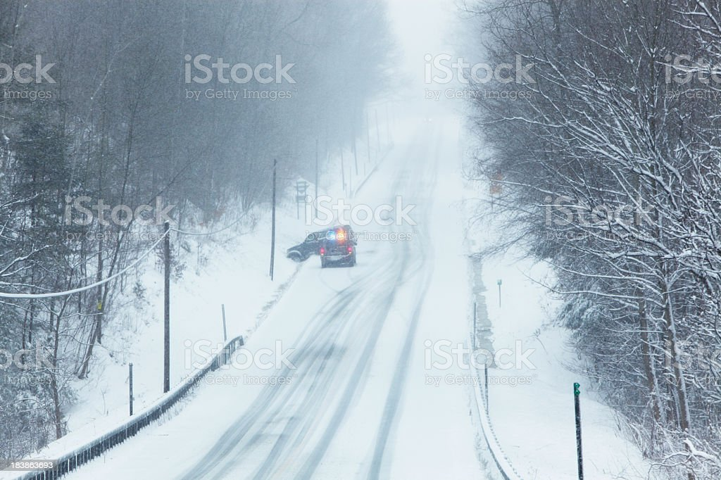 Winter Car Accident on Rural Steep Slippery Road royalty-free stock photo