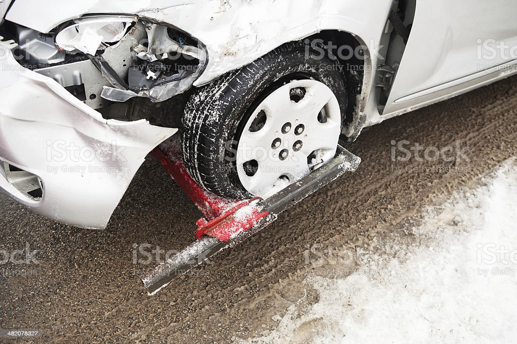 Winter Car Accident, Vehicle Damaged Front and Tow Truck royalty-free stock photo
