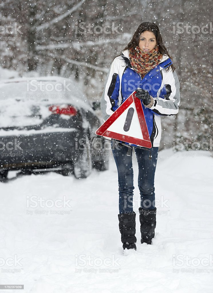 Winter Car Breakdown, Woman Warning Triangle, Snowstorm royalty-free stock photo