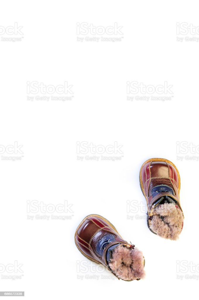 Winter children's shoes isolated on white background royalty-free stock photo